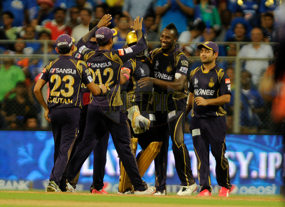Andre Russell of Kolkata Knight Riders celebrates after taking a catch to get the wicket of Ambati Rayudu of Mumbai Indians during match 51 of the Pepsi IPL 2015 (Indian Premier League) between The Mumbai Indians and The Kolkata knight Riders held at the Wankhede Stadium in Mumbai, India on the 14th May 2015.<br /> <br /> Photo by:  Pal Pillai / SPORTZPICS / IPL