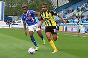 Joe Widdowson out runs Alexander McQueen during the Sky Bet League 2 match between Carlisle United and Dagenham and Redbridge at Brunton Park, Carlisle, England on 12 September 2015. Photo by Craig McAllister.
