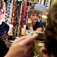 TAMPA, FL -- March 6, 2010 -- Owner Sherry King, helps vintage collector Amy Mayo, a vacationer from Charlottesville, Virginia, with earrings at Sherry's YesterDAZE in Tampa, Fla., on Saturday, March 6, 2010.  Tampa and the surrounding area has become a hub for vintage clothing, furniture, and trinkets.