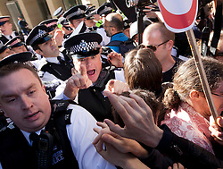 © Licensed to London News Pictures. 15/10/2011. LONDON, UK. Police scuffle with Occupy London protesters at an entrance to Paternoster Square during the Occupy London protest. Photo credit: Matt Cetti-Roberts/LNP