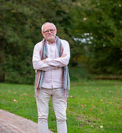 Old Westbury, New York, U.S. October 19, 2019. JERZY KĘDZIORA (JOTKA) poses outdoors standing with crossed arms across his chest, on the grounds of the Old Westbury Gardens, after the Polish sculptor was a panelist there during Closing Reception for his Balance in Nature outdoor sculptures exhibit at the Long Island Gold Coast estate.