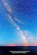 Photograph by Stephan hoglund of the Milky Way and the Apostle Island Lighthouses on Outer Island, Devils Island and Sand Island. Shot from near Lutsen Minnesota