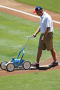 ANAHEIM, CA - JULY 10:  A groundskeeper lines the third base line before the Los Angeles Angels of Anaheim game against the Seattle Mariners on July 10, 2011 at Angel Stadium in Anaheim, California. (Photo by Paul Spinelli/MLB Photos via Getty Images)