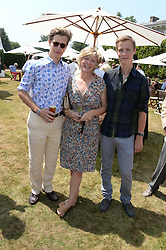 Left to right, LORD SETTINGTON, the COUNTESS OF MARCH and the HON.WILLIAM GORDON-LENNOX at the Cartier 'Style et Luxe' part of the Goodwood Festival of Speed, Goodwood House, West Sussex on 14th July 2013.