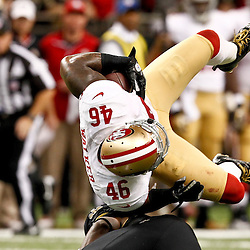 November 25, 2012; New Orleans, LA, USA; New Orleans Saints free safety Isa Abdul-Quddus (42) upends San Francisco 49ers tight end Delanie Walker (46) after a catch during the second half of a game at the Mercedes-Benz Superdome. The 49ers defeated the Saints 31-21. Mandatory Credit: Derick E. Hingle-US PRESSWIRE