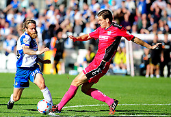 Bristol Rovers' Stuart Sinclair is challenged by Dover Athletic's Tom Bonner - Photo mandatory by-line: Neil Brookman - Mobile: 07966 386802 - 04/10/2014 - SPORT - Football - Bristol - Memorial Stadium - Bristol Rovers v Dover - Vanarama Football Conference