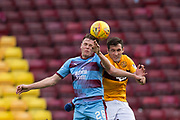 3rd November 2018, Fir Park, Motherwell, Scotland; Ladbrokes Premiership football, Motherwell versus Dundee; Lewis Spence of Dundee competes in the air with Carl McHugh of Motherwell