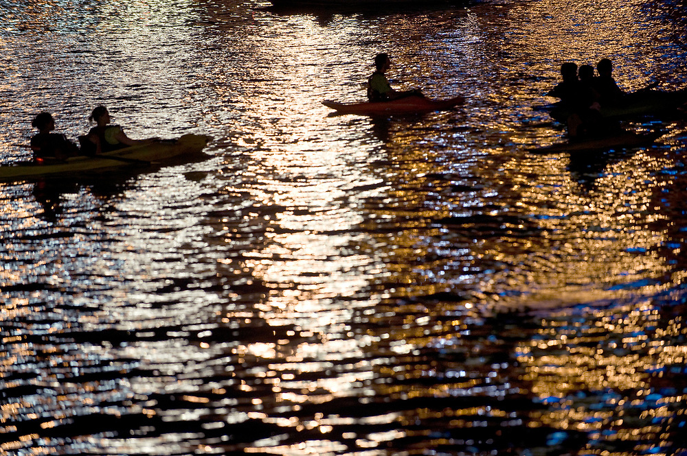 Kayakers partcipating in Venture Outdoors'  Fourth of July Paddle float on the Allegheny River before the fireworks begin in Pittsburgh.