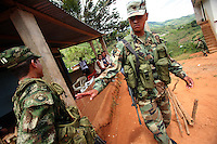 Colombian soldiers provide extra security in El Campanario, where manual eradication efforts of the coca crops are taking a toll on the local economy, in a remote area of the southern Colombian state of Nariño, on Thursday, June 21, 2007. (Photo/Scott Dalton)