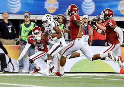 Texas A&M Aggies running back Trey Williams (20) races to the endzone for a 30 yard touchdown run during the third quarter of the 77th AT&T Cotton Bowl Classic between the Texas A&M University Aggies and the Oklahoma University Sooners at Cowboys Stadium in Arlington, Texas. Texas A&M wins the 77th AT&T Cotton Bowl Classic against Oklahoma, 41-13.