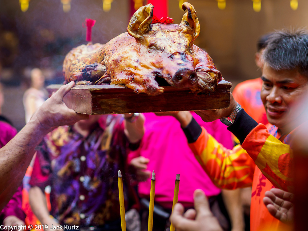 05 FEBRUARY 2019 - BANGKOK, THAILAND:  Members of Canton Shrine in Bangkok present a whole roast pig as an offering during Chinese New Year celebrations at the shrine. Chinese New Year celebrations in Bangkok started on February 4, 2019, although the city's official celebration is February 5 - 6. The coming year will be the Year of the Pig in the Chinese zodiac. About 14% of Thais are of Chinese ancestry and Lunar New Year, also called Chinese New Year or Tet is widely celebrated in Chinese communities in Thailand.      PHOTO BY JACK KURTZ
