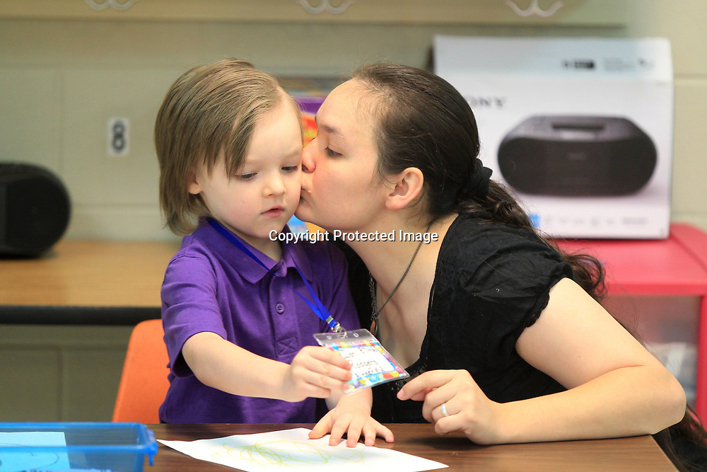 Ian Rodgers, 5, a kindergartener at Saltillo Primary School, receives a goodbye kiss from his mother Rebecca Wilson as she leaves him for his first day of school on Thursday morning.