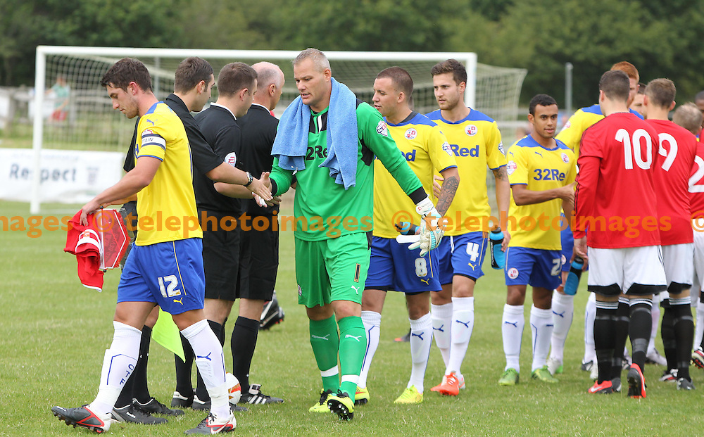 Crawley Town players meet the officials before the Pre season friendly between Billingshurst Football Club and Crawley Town at the Jubilee Fields in Billingshurst. July 11, 2014.<br /> James Boardman / TELEPHOTO IMAGES