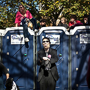 People climbed on top of portable toilets to get a better view of the stage at the Rally to Restore Sanity and/or Fear on the National Mall in Washington, D.C. on Saturday, October 30th, 2010...(Samuel Corum for TBD)