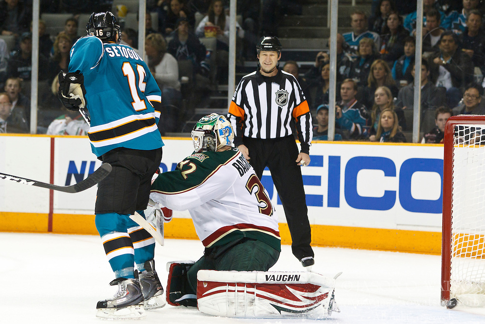 January 22, 2011; San Jose, CA, USA; San Jose Sharks right wing Devin Setoguchi (16) scores a goal past Minnesota Wild goalie Niklas Backstrom (32) during the second period at HP Pavilion. Mandatory Credit: Jason O. Watson / US PRESSWIRE