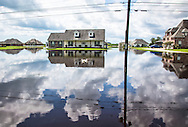Paulina Louisiana in St. James Parish flooded by backflow days after a thousand year rainstorm,  where many were able to keep the floodwater out of their homes with sandbags and pumps  going around the clock.