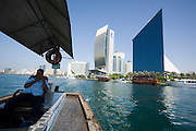 Dubai Creek. Deira skyline. Sheraton Dubai Creek (large cube l.), National Bank of Dubai (round facade, m.) and Dubai Chamber of Commerce (r., slant roof)
