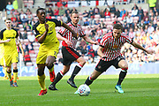 Burton Albion's Marvin Sordell and Sunderland's Adam Matthews during the EFL Sky Bet Championship match between Sunderland and Burton Albion at the Stadium Of Light, Sunderland, England on 21 April 2018. Picture by John Potts.