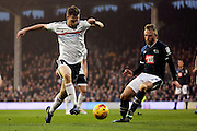 Fulham defender Tomas Kalas (26) taking on Derby County striker Johnny Russell (7) during the EFL Sky Bet Championship match between Fulham and Derby County at Craven Cottage, London, England on 17 December 2016. Photo by Matthew Redman.