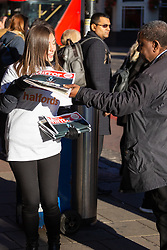 Free copies of the Daily Mirror are handed out as part of a Daily Mirror promotion with Halfords. Waterloo Station, London, October 29 2018.