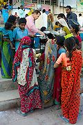 Food aid for the poor at Dashashwamedh Ghat in Holy City of Varanasi, Benares, India