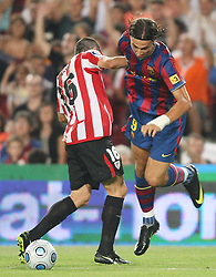 FC Barcelona's Zlatan Ibrahimovic (r) and Athletic de Bilbao's Pablo Orbaiz during the Supercup of Spain.August 23 2009.