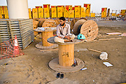 Dubai . .Foreign worker  take a  moment of rest  on a day  off  along  Sheikh Zayed Road entering Dubai from  Abu Dhabi