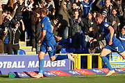 AFC Wimbledon striker James Hanson (18) celebrating after scoring goal to make it 1-0 during the EFL Sky Bet League 1 match between AFC Wimbledon and Shrewsbury Town at the Cherry Red Records Stadium, Kingston, England on 3 November 2018.