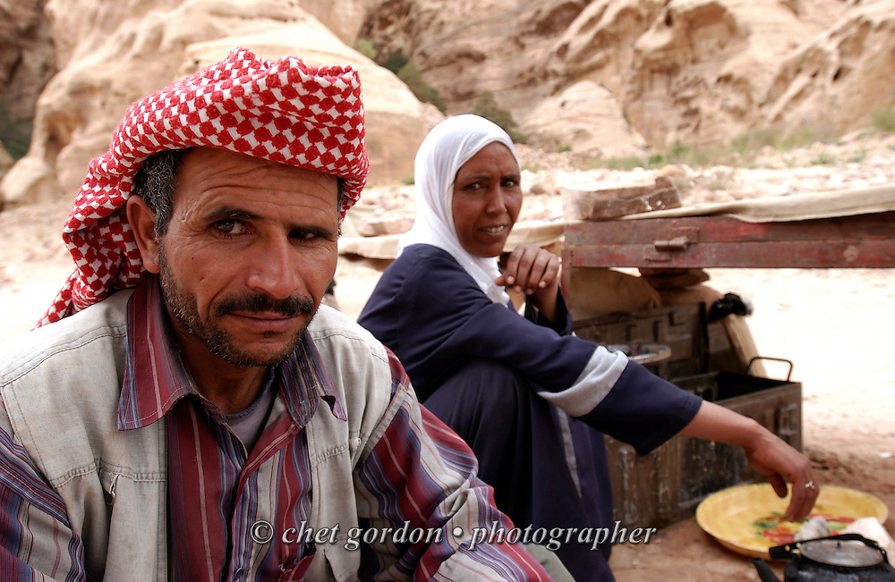 A Bedouin family sits near their souvenir stand in the ancient city of Petra, Jordan on April 28, 2006. Petra is considered the most famous and gorgeous site in Jordan located about 262 km south of Amman and 133 km north of Aqaba. It is the legacy of the Nabataeans, an industrious Arab people who settled in southern Jordan more than 2000 years ago. Admired then for its refined culture, massive architecture and ingenious complex of dams and water channels, Petra is now a UNESCO world heritage site that enchants visitors from all corners of the globe.