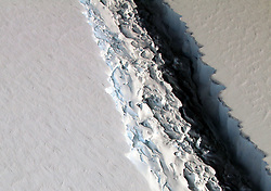May 4, 2017 - Antarctica - The shape of the world is hanging by a thread or rather, according to experts, by a 110 mile-long (177km) rift. That's the extent of a rapidly expanding crack in an enormous ice shelf in Antarctica. When the Larsen C shelf finally splits, the largest iceberg ever recorded (bigger than the US state of Rhode Island and a third the size of Wales) will snap off into the ocean. Widening each day by 3 ft (1 m), the groaning cleft is on the verge of dramatically redrawing the southern-most cartography of our planet and is likely to lead, climatologists predict, to an acceleration in the rise of sea levels globally. (Credit Image: © NASA via ZUMA Wire/ZUMAPRESS.com)