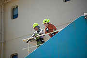 Two workmen onboard the Maersk Attender