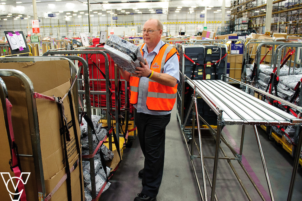 Andy Brook sorts some ASOS parcels as they come into the centre<br /> <br /> The team at the Royal Mail's Yorkshire Delivery Centre have won a lucrative new contract with online retail giants ASOS with the Tracked 48 product.<br /> <br /> Date: December 2, 2015