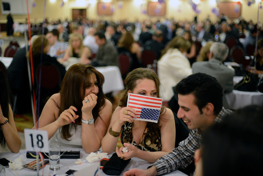 Iraqis refugees at the Bellagio Banquet Hall celebrating Akitu, the Chaldean - Assyrian New Year. Conflict and human tragedy have defined the shared history of the United States and Iraq in recent decades. This violent and painful history has brought to America tens of thousands of Iraqi refugees whose scars, experiences, enterprise, traditions and culture are now becoming integral parts of the American landscape. Sterling Heights, MI, USA. 12/04/2013.