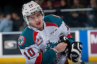 KELOWNA, CANADA - FEBRUARY 14: Nick Merkley #10 of Kelowna Rockets grimaces after a high stick to the face against the Moose Jaw Warriors on February 14, 2015 at Prospera Place in Kelowna, British Columbia, Canada.  (Photo by Marissa Baecker/Shoot the Breeze)  *** Local Caption *** Nick Merkley;