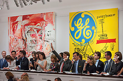 "© Licensed to London News Pictures. 28/06/2017. London, UK. Sotheby's staff bid on behalf of telephone clients in front of (L to R) ""The Girl Who Had Everything"", 1998, by Cecily Brown sold for a hammer price of GBP1.55m (estimate GBP0.8-1.2m) and ""Sweet Pungent"", 1984-85, a collaborative work by Andy Warhol and Jean-Michael Basquiat sold for a hammer price of GBP3.8 m (estimate GBP1.4-1.8m) at Sotheby's Contemporary Art evening sale in New Bond Street, which featured pioneering works from the Pop Art genre. Photo credit : Stephen Chung/LNP"