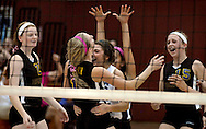 "6 Oct. 2011 -- ST. LOUIS. -- Rosati-Kain High School volleyball players Rebecca Lynch (11) and Mary Wilhelm (16) celebrate with their teammates after scoring a key point during the Kougars' game with Bishop DuBourg High School during a special ""pink game"" between the schools at DuBourg Thursday, Oct. 6, 2011. The ""pink game"" to benefitted SSM St. Mary's Health Care Center's Cancer Care, in honor of Rosati-Kain president Sister Joan Andert, SSND, who is currently undergoing treatment for breast cancer. Photo © copyright 2011 Sid Hastings."