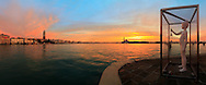 """A glorious sunrise over the San Marco basin on a cold december morning, after a stormy and rainy night. """"Boy with frog"""" is a sculpture in white steel of the LA based artist Charles Ray. It's prominently situated on the very tip of the Punta della Dogana, exactly where the Grand Canal, the Giudecca Canal and the San Marco basin converge, and it was placed here at the beginning of June 2009 for the opening of the new exhibition center at the Dogana. I took this picture at dawn at the beginning of December. It had been rainy all the day and the night before, but the sky finally broke just in time for putting on stage one of the best sunrise I have ever witnessed. This is a stitch of 8 vertical frames, covering a field of view of nearly 180°"""
