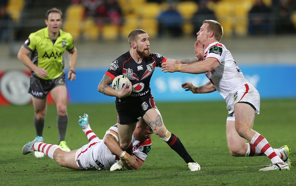 Sam Tomkins of the New Zealand Warriors is tackled by by Trent Merrin, left, and Captain Ben Creagh of the Dragons during their round 22 NRL match at Westpac  Stadium, Wellington on  Saturday, August 08, 2015. Credit: SNPA / David Rowland