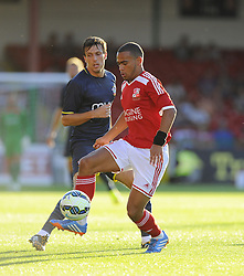 Swindon Town's Louis Thompson battles for the ball with Southampton's Jack Cork - Photo mandatory by-line: Joe Meredith/JMP - Mobile: 07966 386802 21/07/2014 - SPORT - FOOTBALL - Swindon - County Ground - Swindon Town v Southampton