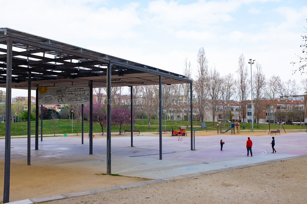 A family plays basketball in an empty Parc Barnils. Emtpy streets in Sant Cugat del Valles, a city of some 90,000 people outside Barcelona, on the day before Spain exerted a state of Emergency to deal with the spread Coronavirus. Spain is one of the worst affected countries. Schools and retail businesses are closed, except for supermarkets and pharmacies.
