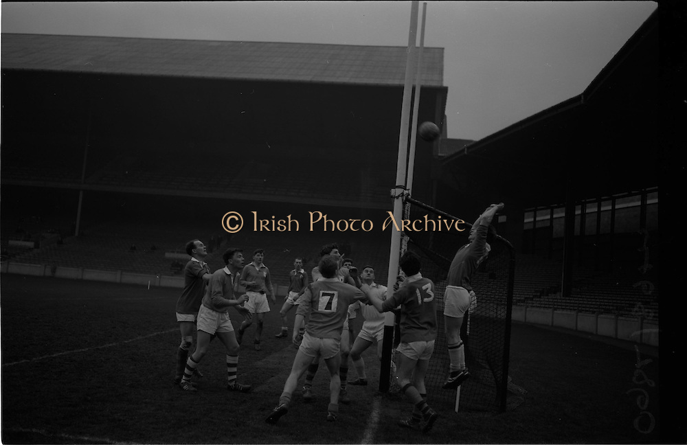 21/02/1965.02/21/1965.21 February 1965.Munster v Ulster Railway Cup semi-final at Croke Park. The final score was Ulster 0-14 Munster 0-9.. All eyes on the ball as it crosses over for Munster's point. .