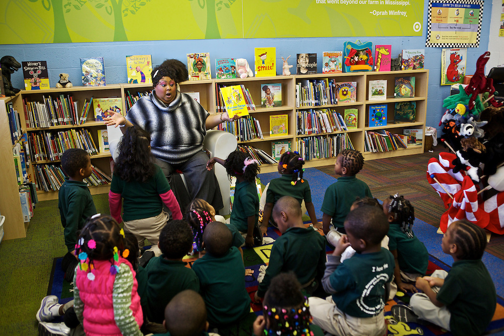 "Library Assistant Wykana Tabor reads ""Curious George Rides a Bike"" inside the new library that was renovated through the Target School Library Makeover Grant at Adelaide Davis Elementary School on Nov. 26, 2012 in Washington, D.C. Last week DCPS Chancellor Kaya Henderson proposed closing 20 under-enrolled schools in the District. Davis Elementary is one of 20 schools in the DCPS system included in the school closure proposal. ..CREDIT: Lexey Swall for The Wall Street Journal.DCSCHOOLS"