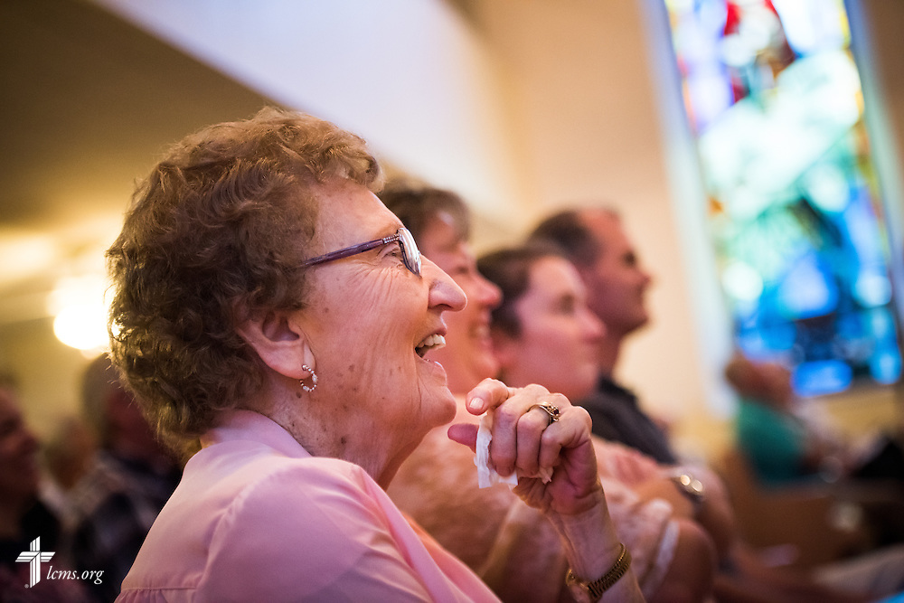 "Parishioner Eunice Hausler laughs during a sermon by the Rev. Dr. Matthew C. Harrison, president of The Lutheran Church–Missouri Synod, on Sunday, August 9, 2015, during a ""Day of Thanksgiving and Rededication""  at St. John's Lutheran Church in New Minden, Ill. Nearly two years ago, a tornado damaged the church and surrounding homes, including Hausler's. LCMS Communications/Erik M. Lunsford"