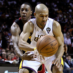 March 10, 2011; Miami, FL, USA; Miami Heat point guard Mario Chalmers (15) knocks the ball away from Los Angeles Lakers point guard Derek Fisher (2)during the second quarter at the American Airlines Arena.  Mandatory Credit: Derick E. Hingle