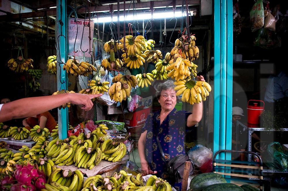 Bananas vendor in a street of Ho Chi Minh city, Vietnam, Southeast Asia
