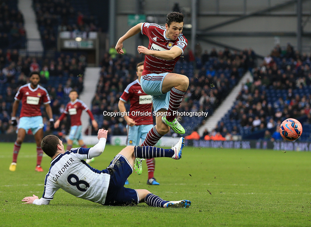 14th February 2015 - FA Cup 5th Round - West Bromwich Albion v West Ham United - Stewart Downing of West Ham United goes down in a tackle with Craig Gardner of West Bromwich Albion - Photo: Paul Roberts / Offside.