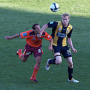 Massimo Murdocca (left) and Matt Simon in action during the Central Coast Mariners V Brisbane Roar A-League match at Bluetongue Stadium, Gosford, Australia, 19 December 2009. Photo Tim Clayton