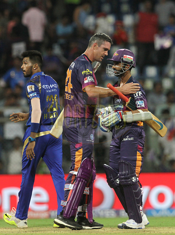 Rising Pune Supergiants player Kevin Pietersen congratulates and Rising Pune Supergiants player Ajinkya Rahane after winning the match 1 of the Vivo Indian Premier League ( IPL ) 2016 between the Mumbai Indians and the Rising Pune Supergiants held at the Wankhede Stadium in Mumbai on the 9th April 2016<br /> <br /> Photo by Vipin Pawar/ IPL/ SPORTZPICS