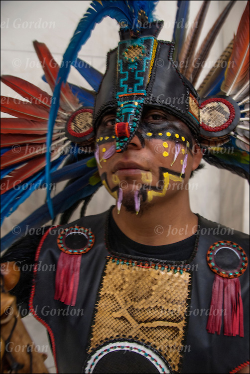 Portrait of Naz Cruz is a dancer in Danza Mexikah, the image  taken after ceremonial dance on the Day of the Dead on the rotunda in the National Museum of the American Indians.<br /> <br /> Cetiliztli Nauhcampa Quetzacoatl in Ixachitlan (Group of the Four Directions on the East of the Continent) for more information: <br /> <br /> http://cetiliztli.blogspot.com/<br /> <br /> It is &quot;a cultural, spiritual, artistic, political and educational circle made up of community and family members who carry on their ethnic pride and the ancient traditions of native people's of this continent&quot;.
