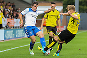 Bury FC defender Craig Jones (2) challenges with Burton Albion defender Damien McCrory (14) during the EFL Cup match between Burton Albion and Bury at the Pirelli Stadium, Burton upon Trent, England on 10 August 2016. Photo by Aaron  Lupton.